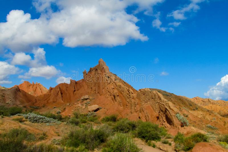 Colorful castle shape mountains, yellow and different color painted hills stock photography