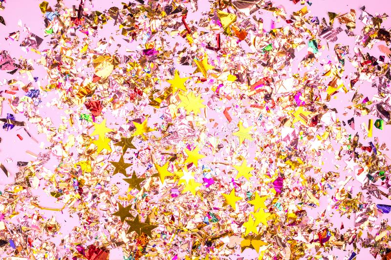 Colorful celebration background with confetti,stars, fireworks and decoration on pink background. stock photos