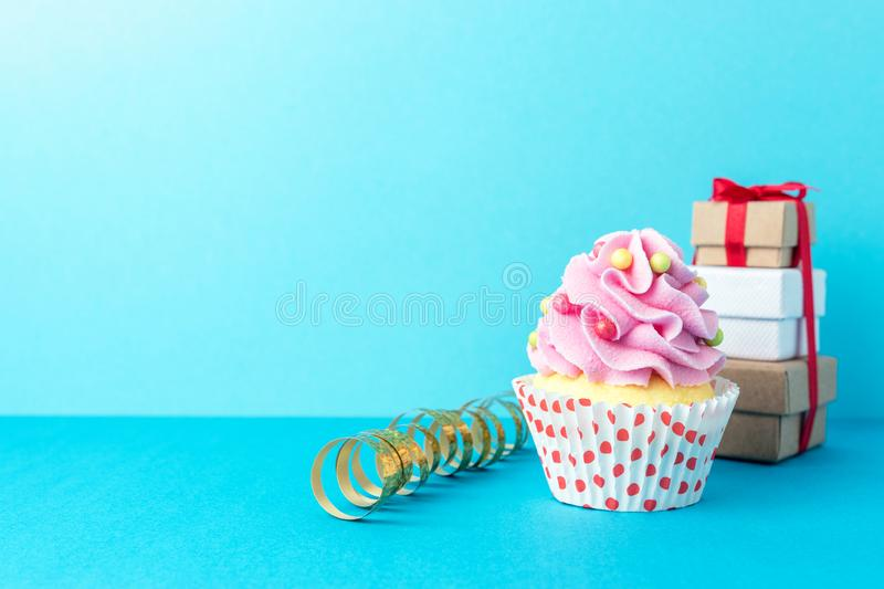 Colorful celebration background with cupcake. Minimal party concept royalty free stock image