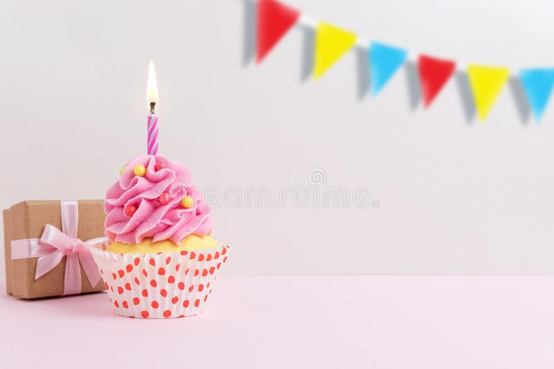 Colorful celebration background with cupcake. Minimal party concept stock photography