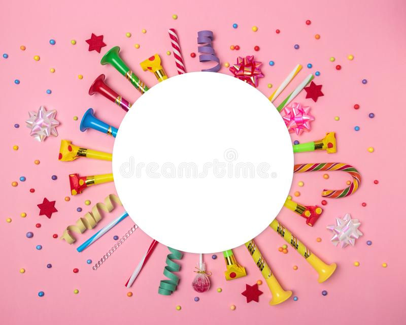 Colorful celebration background with various party confetti, streamers and decoration. Minimal party concept. Flat lay stock photography