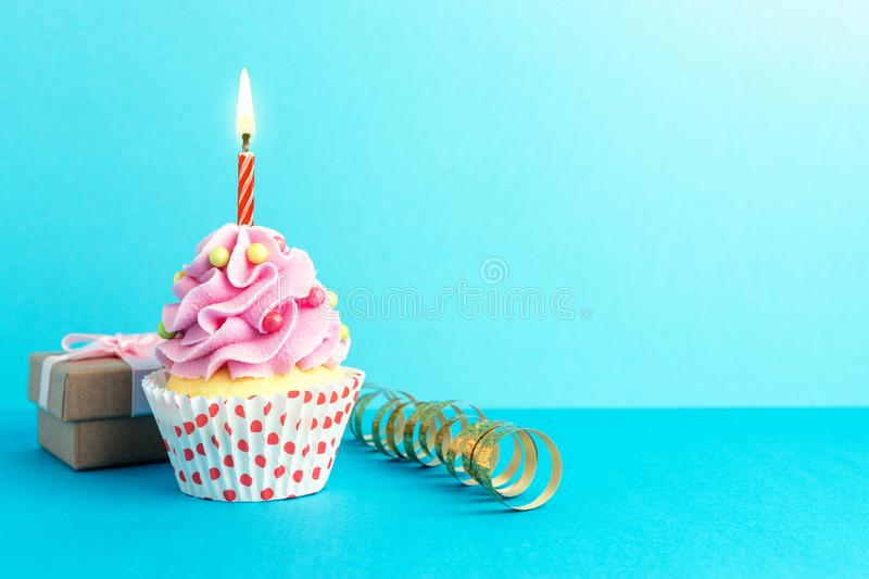 Colorful celebration background with various party decoration and cupcake. Minimal party concept royalty free stock photos