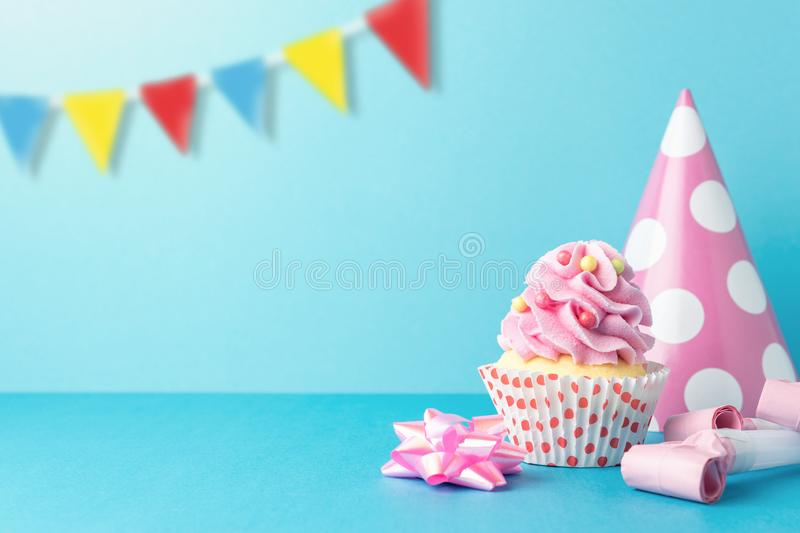 Colorful celebration background with various party decoration and cupcake. Minimal party concept stock photos