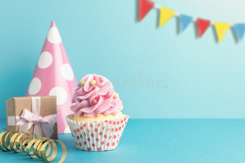Colorful celebration background with various party decoration and cupcake. Minimal party concept royalty free stock images