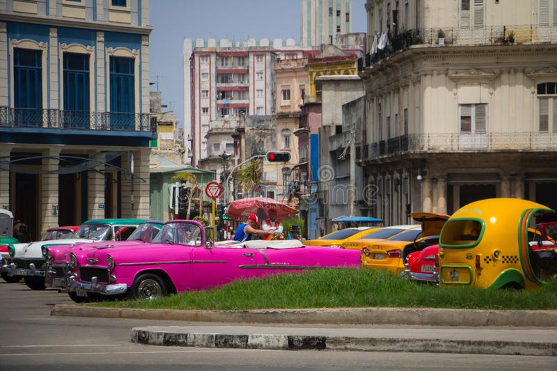 Colorful central square in Havana. Colorful central square with retro cars in Havana. Cuba city lifestyle royalty free stock images