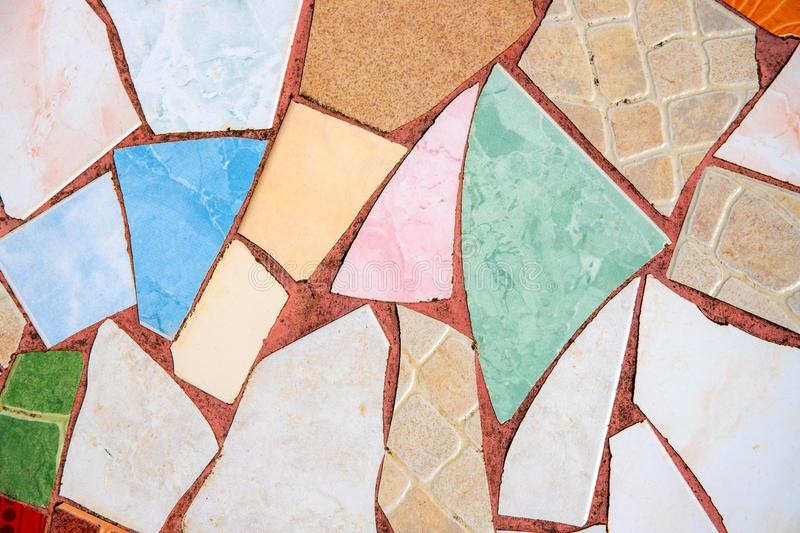Colorful ceramic mosaic floor. Creative recycled mosaic top view photo. Bathroom or kitchen floor design idea. Blue yellow ceramic tiles. Reused broken tile stock image