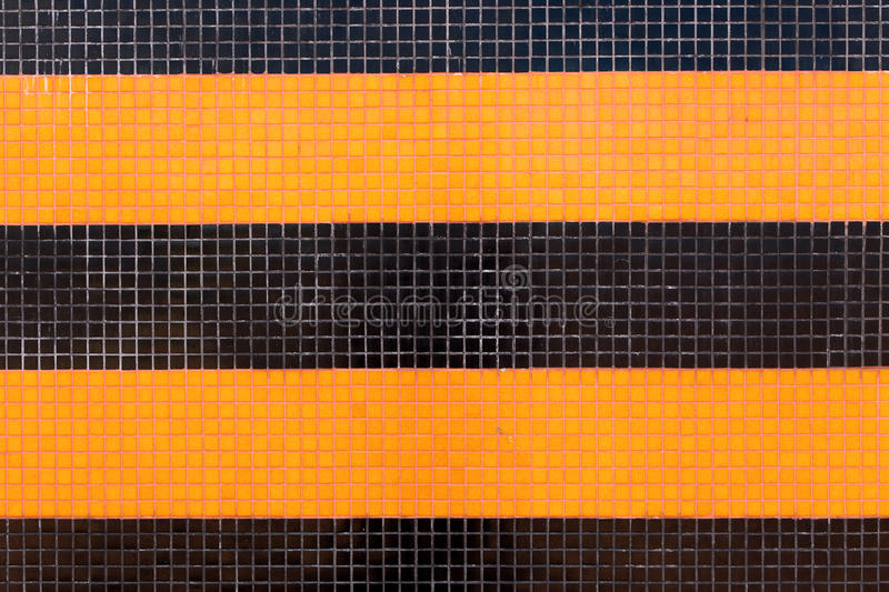 Colorful ceramic tiles mosaic - orange and black stock image