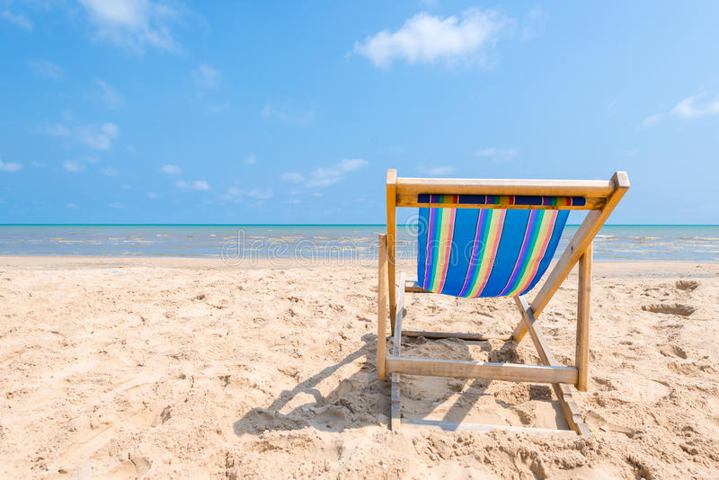 Colorful chair on sandy beach on sunny day looking for the blue. Sea, relaxation concept stock photo
