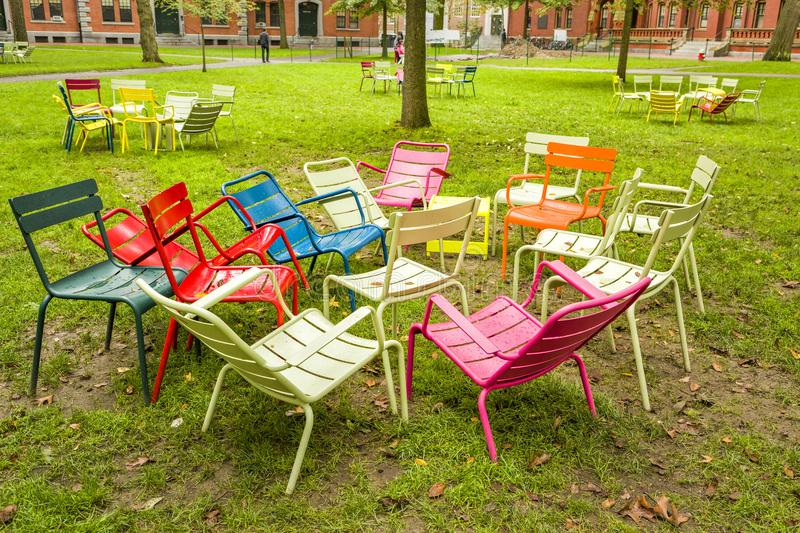 Harvard University Yard colourful chars assembly. Colorful chairs after a group session in the yard of Harvard University, Boston Massachusetts, USA stock photography