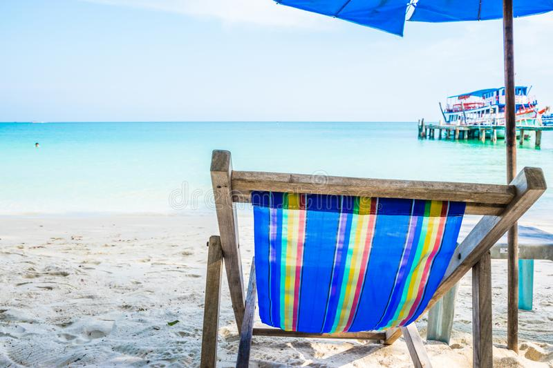 Colorful chairs and White umbrellas on the beach at Samed Island, Thailand royalty free stock images