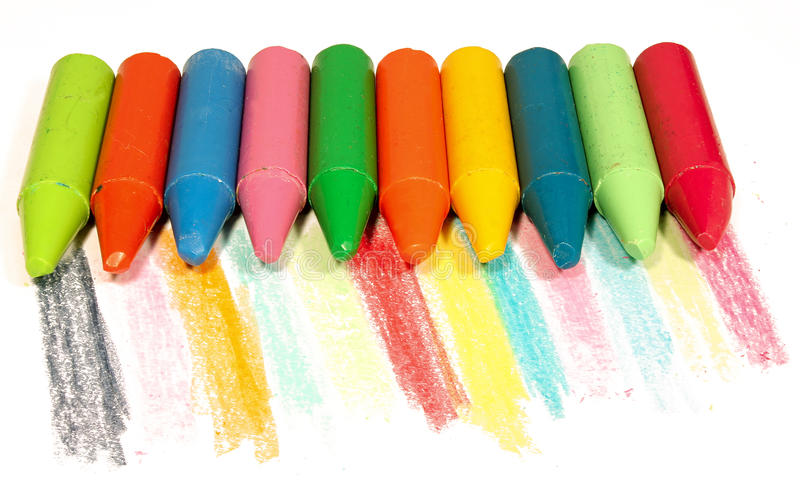 Colorful chalk. On white paper with scribbles royalty free stock photo