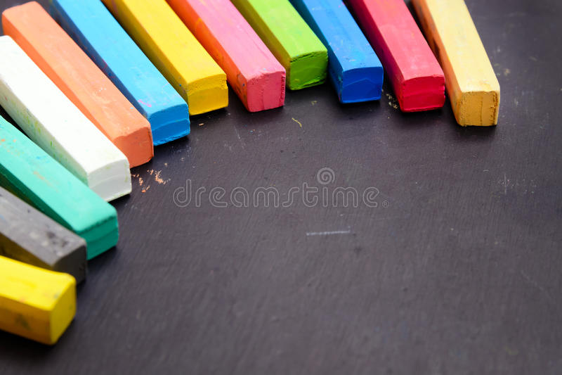 Colorful chalk. On wooden blackboard stock image