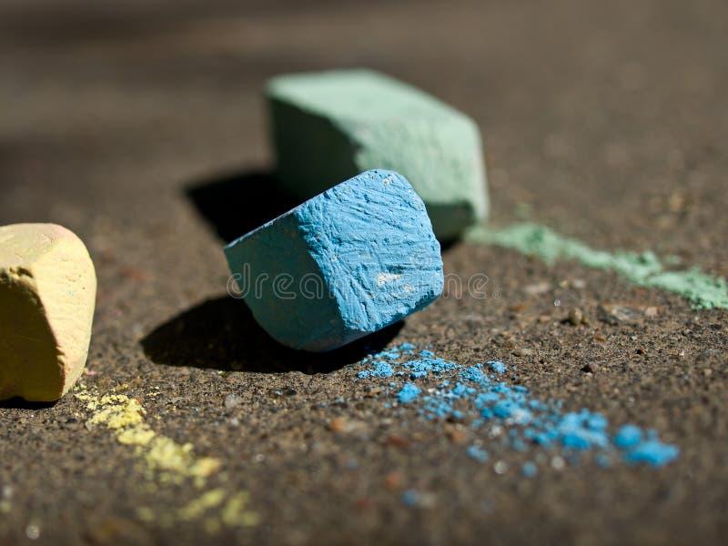 Colorful chalk on asphalt. Sunny day stock images