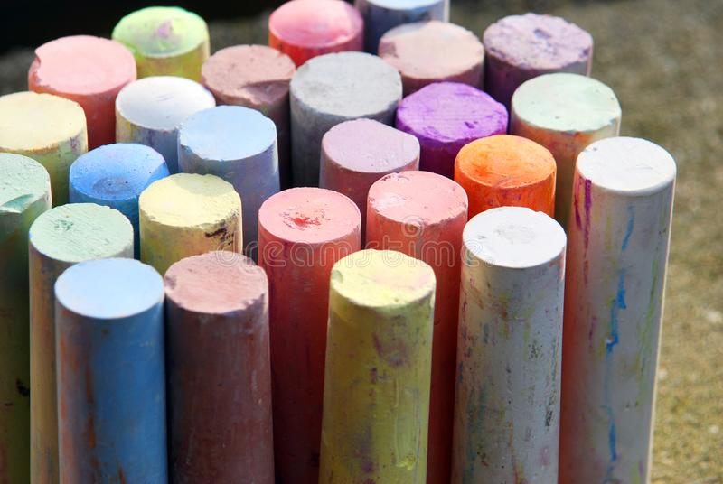 Colorful chalk crayons for street painting. A lot of colorful chalk crayons for painting on the asphalt royalty free stock photo