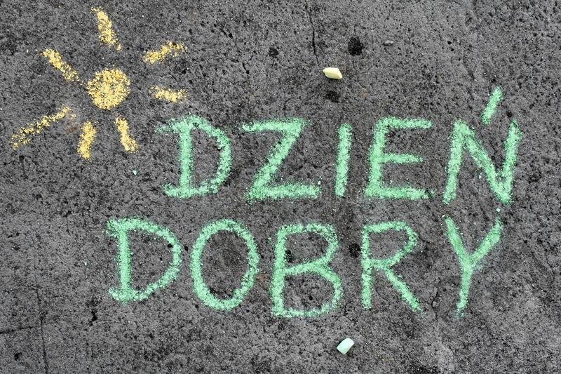 Chalk drawing: Polish words GOOD MORNING. Colorful chalk drawing on asphalt: Polish words GOOD MORNING stock photography