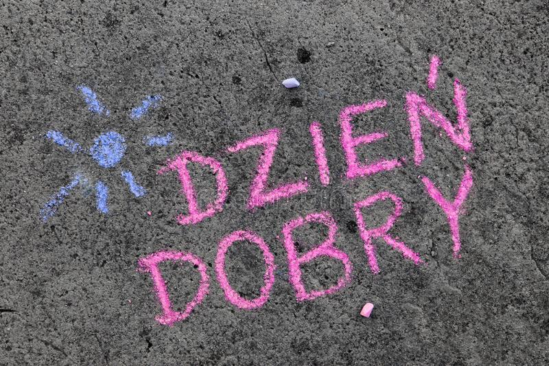Chalk drawing: Polish words GOOD MORNING. Colorful chalk drawing on asphalt: Polish words GOOD MORNING royalty free stock photos