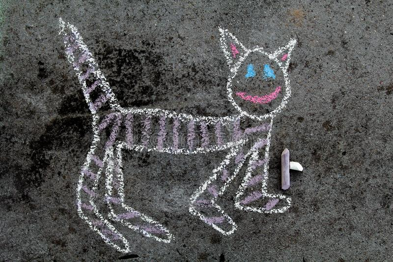 Colorful chalk drawing: funny cat stock photography