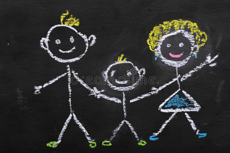 Colorful chalk illustration of family by kid. On blackboard royalty free stock image
