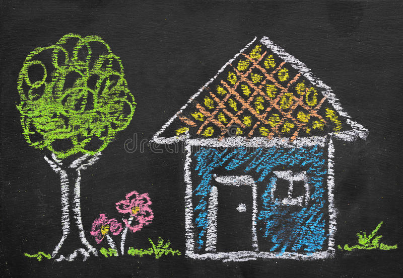 Colorful chalk illustration of home by kid. On blackboard royalty free stock images