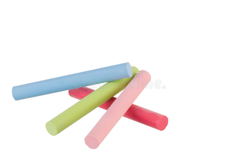 Colorful chalk sticks. With with copy space and isolated on a white background royalty free stock photography
