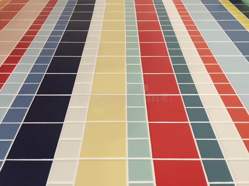 Colorful checked pattern of bathroom floor tiles stock photography