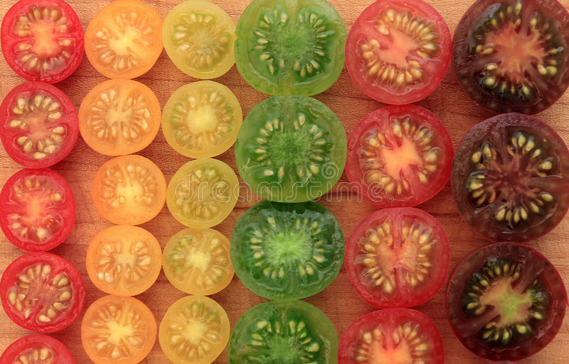 Colorful cherry tomato background stock images