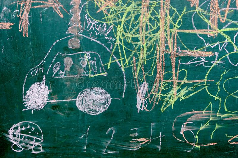 Authentic colorful children`s chalk drawing on the blackboard stock images