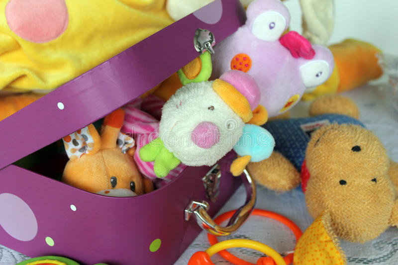 Colorful children's toys in suitcase. Colorful children's toys in a small suitcase royalty free stock photos