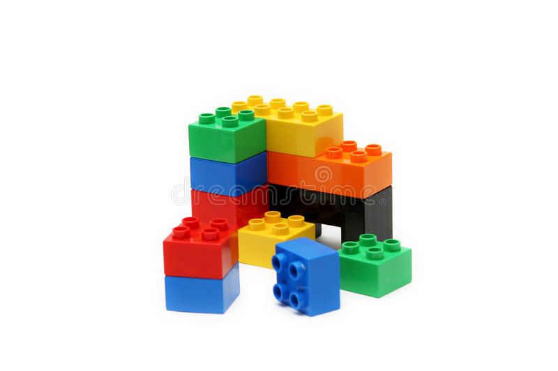 Colorful childrens building blocks with white background stock photos