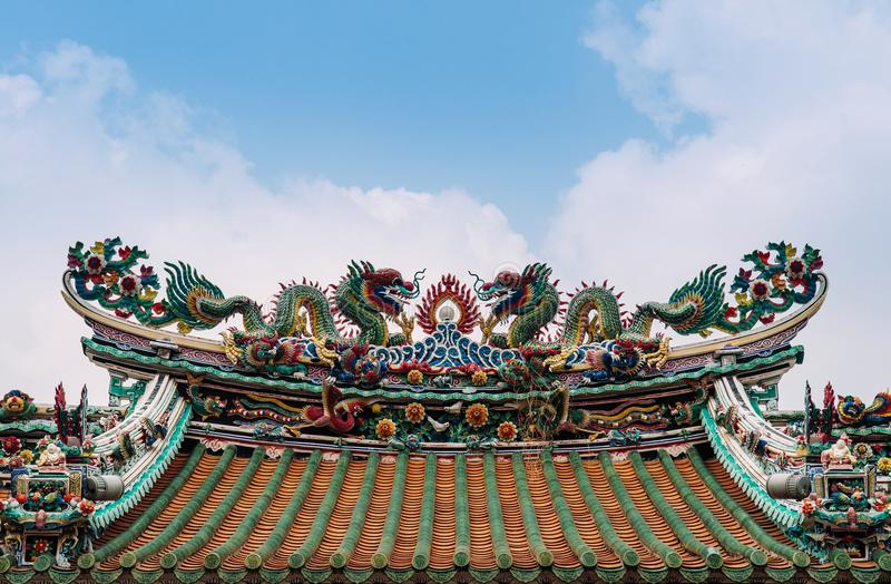 Colorful Chinese temple roof decoration ornament with dragon and stock photo