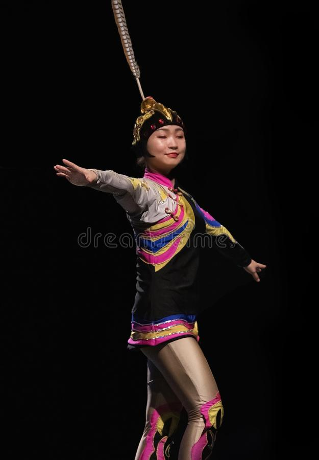 Colorful Chinese Troupe Performer at Florida State Fair in Tampa. A colorful performer from the Zaji Amazing Acrobats of China entertains at the Florida State royalty free stock photo
