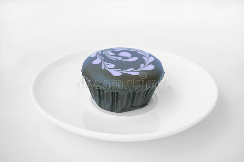 Colorful  chocolate cupcake with topping royalty free stock images