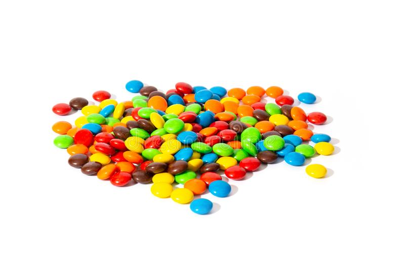 Colorful chocolate MMs in and out of focus on white background.  royalty free stock photos