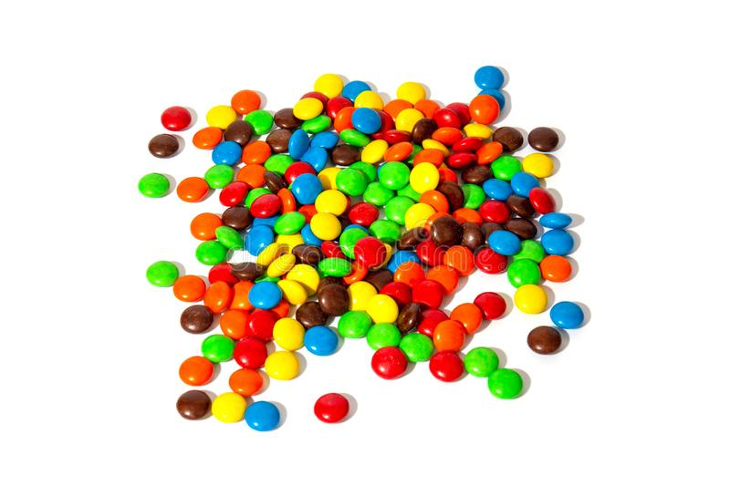 Colorful chocolate MMs in and out of focus on white background.  royalty free stock image