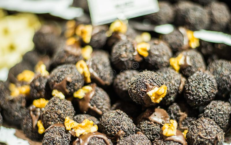 Colorful chocolate truffle candies at a street food market. Colorful chocolate truffle candies at street food market royalty free stock images