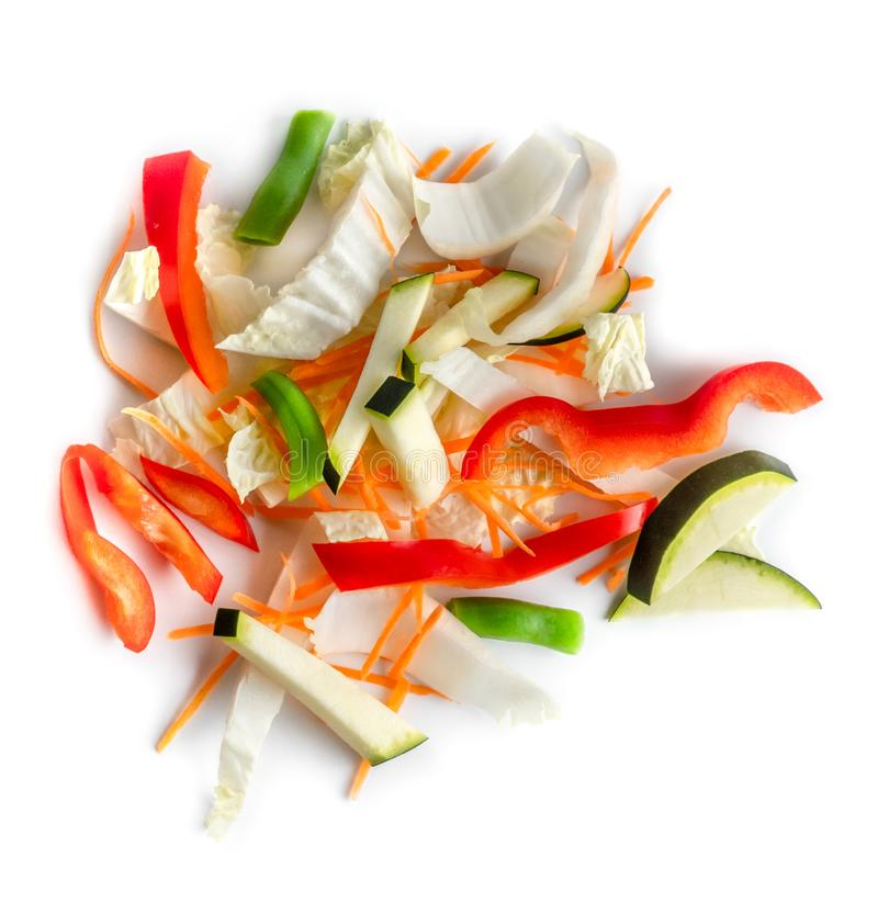 Colorful chopped fresh vegetables mix, green beans, zucchini, red peppers, cabbage isolated on a white background royalty free stock image