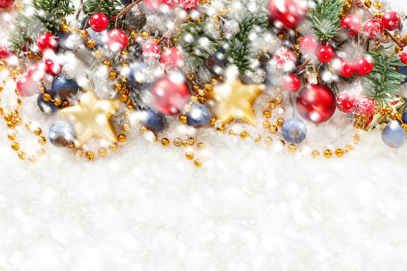Colorful Christmas background border with white smowfall.  stock photography