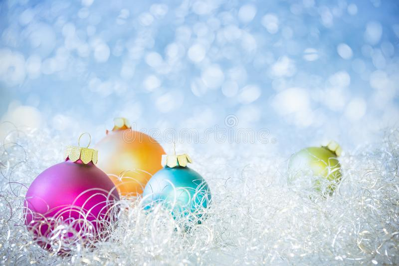 Colorful Christmas Balls with blue Bokeh Background royalty free stock photo