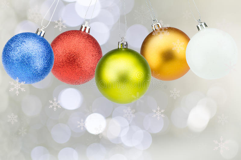 Colorful christmas balls with snowflakes on white bokeh background royalty free stock photography