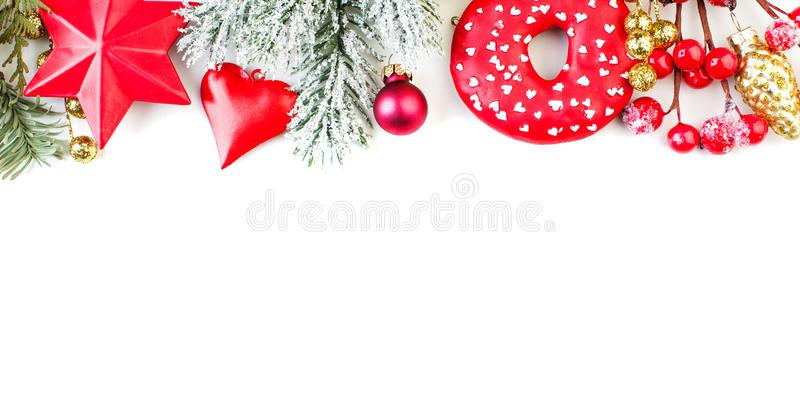 Colorful Christmas border on white. Perfect winter season holiday composition with copy space royalty free stock photo