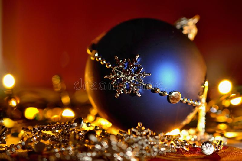 Colorful christmas Decoration. Winter holidays and traditional ornaments on a Christmas tree. Lighting chains - candles for season. Al background royalty free stock photography