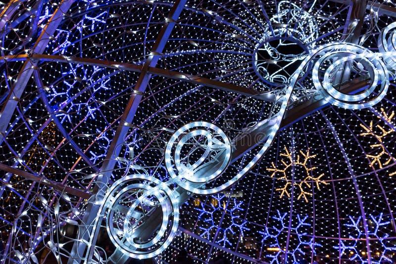 Colorful christmas illumination in city street. Christmas illumination on the street made by blue led rope light royalty free stock image