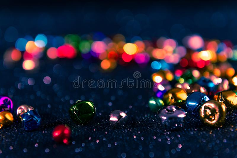 Colorful Christmas jingle bells. Blue filter. Blurred bokeh background. stock images