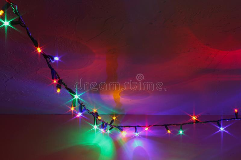 Colorful Christmas Lights Reflecting on Wall Ceiling. Pretty Christmas Holiday lights with reflecting patterns on walls and ceiling. Colorful string of star stock image
