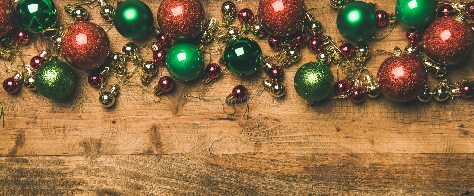 Colorful christmas tree decoration balls on wooden background, copy space royalty free stock photos