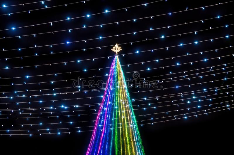 Colorful Christmas tree with light power lines with star at the top at Remate de Paseo Montejo, Merida, Yucatan, Mexico. Colorful lights in a Christmas tree with royalty free stock photos