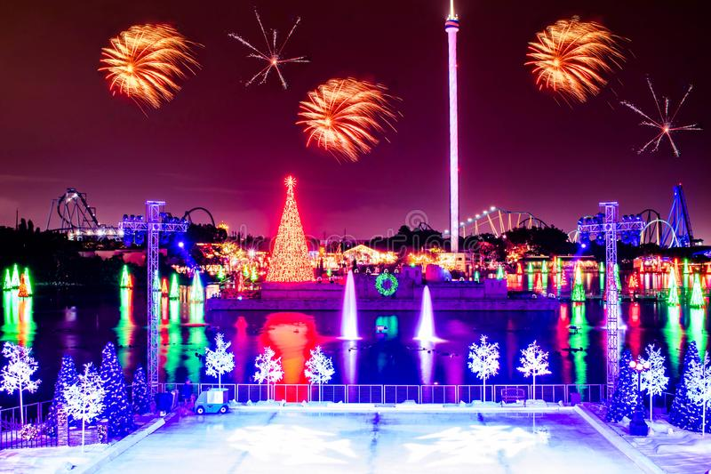 Colorful Christmas Trees on lake and fireworks at Seaworld 1. Orlando, Florida. December 21, 2019. Colorful Christmas Trees on lake and fireworks at Seaworld 1 stock image