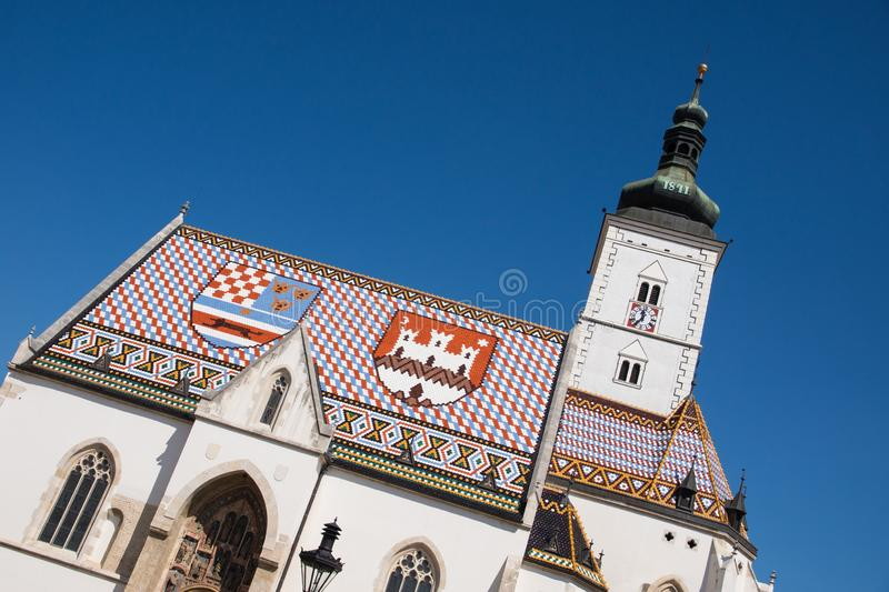 Colorful church tower and roof in Zagreb royalty free stock photos