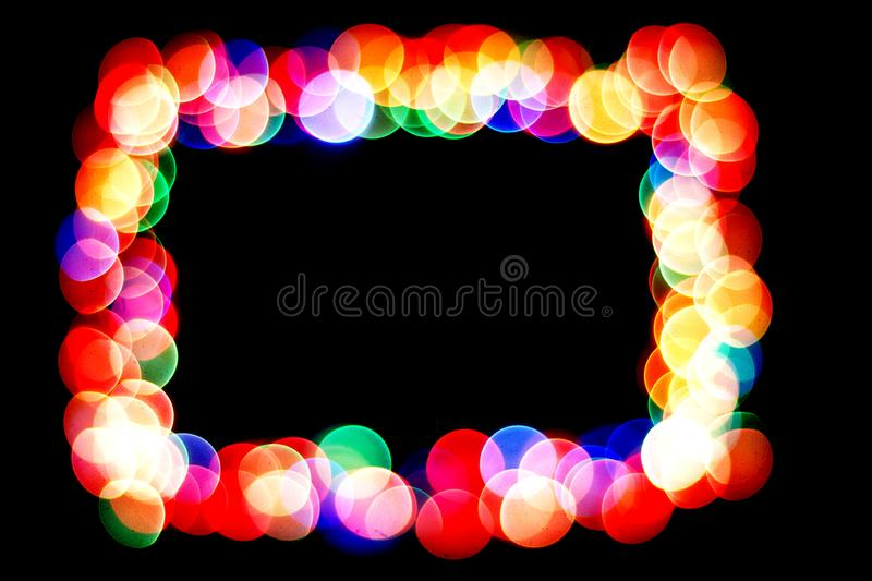 Colorful circles form a frame.bokeh circle isolated on black background.frame of circles royalty free stock photo
