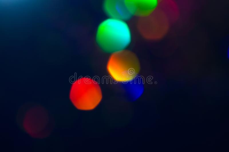 Colorful circles of light abstract background. Holiday texture. Glitter multicolored light spots on dark backdrop, royalty free stock photos